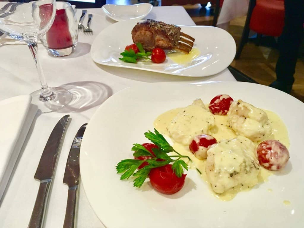 Rack of lamb and fish in creamy sauce Giovannis food italian restaurant knutsford